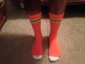 Louis models his SAR orange socks.